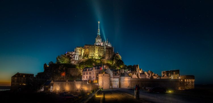 Mont Saint Michel just off the coast in Brittany in France, is one of the most amazing places I have been. I was so glad, that I had the chance to stay after dark. Not only because it looked fantastic, but also because, people left at dinner time.   Mont Saint Michel is one of the most popular tourist destinations in France, and during the day, you can feel that.  --Jacob Surland Easy to read and understand tutorials on www.caughtinpixels.com  Art sale as limited prints. Photo by Jacob Surland,  Licensed Creative Commons non-commercial v4.0.  No Derivative Work. Protected by Pixsy.com.